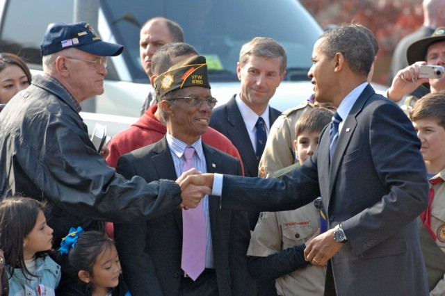 To honor the men and women in uniform, President Barack Obama takes time to meet with veterans at the 8th U.S. Army War Memorial at United States Army Garrison Yongsan, Nov. 11.