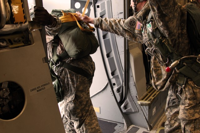A Soldier from 1st Squadron (Airborne), 40th Cavalry Regiment, 4th Brigade Combat Team (Airborne), 25th Infantry Division, assists the jump master with inspection of the aircraft door in preparation for the combined parachute jump Nov. 10. The jump was part of exercise Yudh Abhyas 2010, an exercise designed to promote cooperation between the two militaries.