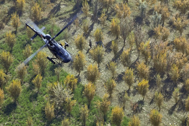 A Task Force Destiny, 101st Combat Aviation Brigade OH-58D Kiowa Warrior helicopter conducts aerial reconnaissance in southern Afghanistan Nov. 8, 2010. (U.S. Army Photo by Task Force Destiny Public Affairs Officer Sadie Bleistein/Released)