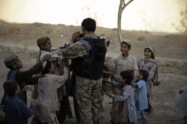 Lifelong policeman passing down commitment to Afghan Security Forces