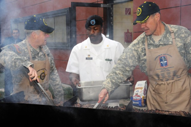 "Lt. Gen. John D. Gardner, U.S. European Command deputy commander, and Brig. Gen. Steven L. Salazar, commanding general of the 7th U.S. Army Joint Multinational Training Command, man the grill during the free steak lunch for Soldiers and their families at the Grafenwoehr Dining Facility, Grafenwoehr, Germany, on Veterans Day, 2010.  The steaks were donated by Cooks from the Valley, a partner in the Department of Defense's ""America Supports You"" program."
