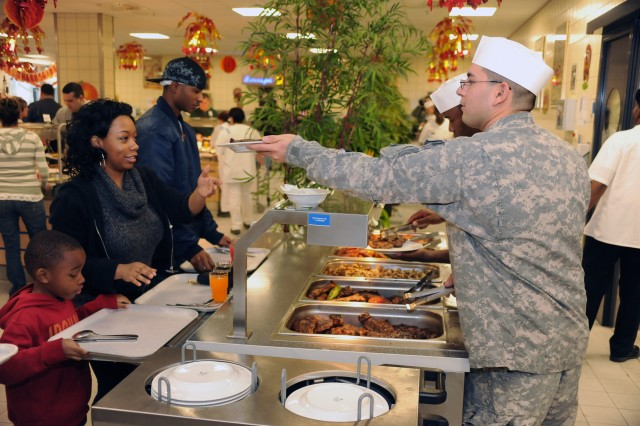 "Staff at the Grafenwoehr U.S. Army Dining Facility serve free steak lunches to members of the Grafenwoehr Military Community on Veterans Day 2010.  The steaks were donated to Soldiers and their families by Cooks from the Valley, a partner in the Department of Defense's ""America Supports You"" program."