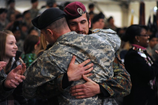 A Soldier from the U.S. Army 12th Combat Aviation Brigade, headquartered in Ansbach, Germany, embraces a German soldier who he helped rescue from a Taliban ambush in Afghanistan during the opening ceremony of ESPN's live broadcast of a special Veterans Day Sportscenter in Grafenwoehr, Germany, Nov. 11, 2010.  It was the first time the German and American Soldiers had seen each other since the rescue mission in April, 2009.
