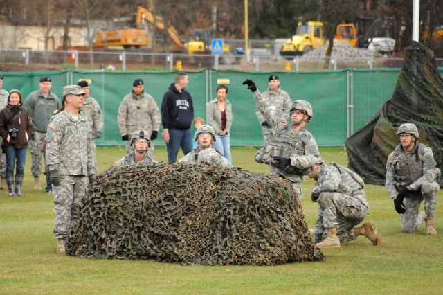 A Soldier from the 172nd Separate Infantry Brigade tosses a grenade during an event of the Warrior Challenge, a Soldier-skill competition, during the live broadcast of ESPN SportsCenters Veterans Day special in Grafenwoehr, Germany, Nov. 11, 2010.
