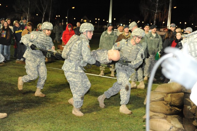 Members of the 173rd Airborne's Warrior Challenge team compete in the litter carry event during ESPN's live broadcast of Sportscenter from Grafenwoehr, Germany on Veterans Day 2010.