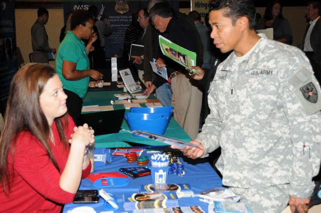 CW3 Paul Ingham, WOCC International Studies instructor, right, gets information about Limestone College from Charlotte Kerr, Limestone College Extended Campus enrollment coordinator, during the NCOA and Military.com Career Expo here Nov. 4.