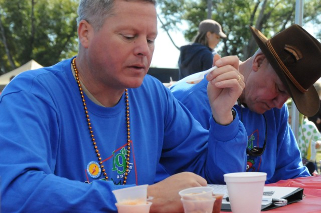 Col. James A. Muskopf, Fort Rucker garrison commander, judges a sample of chili during the 19th annual Chili 5K and Cook-off.