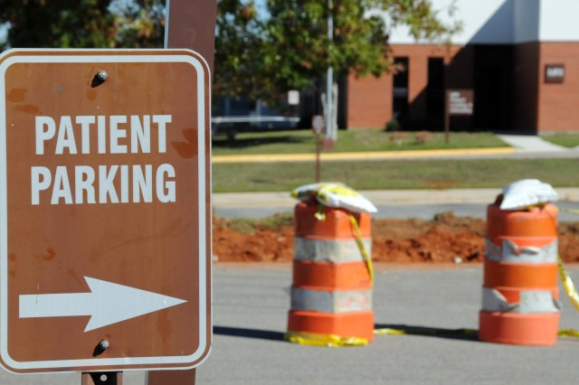 Cones currently mark off the areas of Lyster Army Health Clinic parking under construction for a recently initiated paving project.