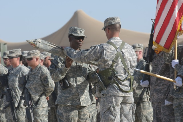 Command Sgt. Maj. Colvin Bennett, left, 68th Combat Sustainment Support Battalion command sergeant major, and Col. Thomas A. Rivard, battalion commander, encase the unit colors during a transfer of authority ceremony Oct. 31 at Camp Leatherneck, Afghanistan.