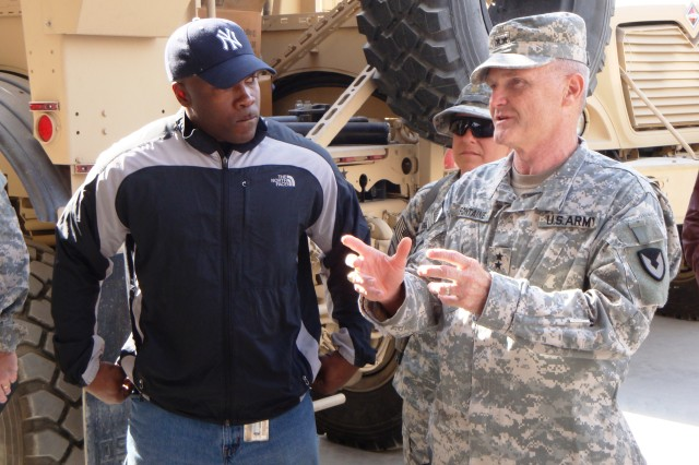 Maj. Gen. Yves J. Fontaine, Army Sustainment Command commanding general, talks with a Forward Operating Base Fente, Afghanistan, Logistics Task Force team member during his visit.