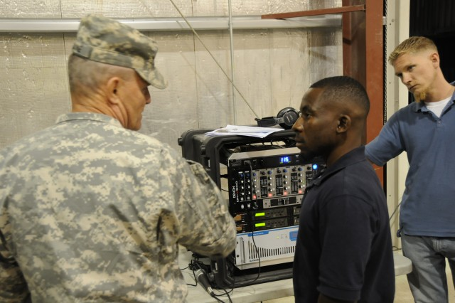 Maj. Gen. Yves J. Fontaine, Army Sustainment Command commanding general, speaks with technicians during a recent trip to Afghanistan.  The ASC's 401st Army Field Support Brigade is the Army Materiel Command's operational arm for the Materiel Enterprise in theater.