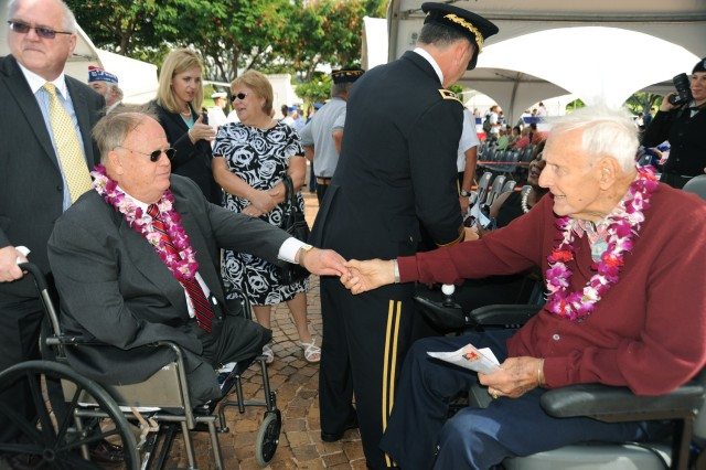 The Hon. Max Cleland (left) and Lt. Gen. (Ret.) Tom Rienze greet one and other at the Veterans Day ceremony at the National Cemetery of the Pacific (Punchbowl) in Honolulu. Rienze, 91, a World War II, Korean War and Vietnam veteran, commanded Cleland during his service in Vietnam and served as the deputy commander of the 1st Signal Brigade. Cleland, who served in the U.S. Senate, from suffered severe injuries during his service and became an inspiration to all veterans. (U.S. Army photo by B.J. Weiner).