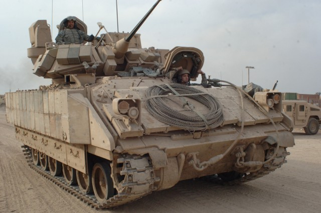 U.S. Army Soldiers from 1st Battalion, 8th Cavalry Regiment, attached to 2nd Infantry Brigade Combat Team, 2nd Infantry Division drive a Bradley Fighting Vehicle to an assembly area at Camp Rustamiyah in East Baghdad, Iraq, prior to a patrol in the Baladiat area Feb. 15, 2007.