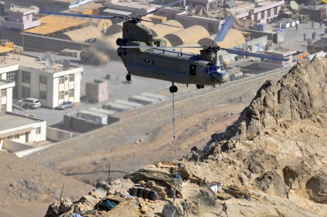 A Task Force Destiny, 101st Combat Aviation Brigade CH-47 Chinook helicopter piloted by Capt. David Jenkins and Chief Warrant Officer 2 Andrew Lau pick up accumulated slings left from previous sling-load resupply missions delivered to Task Force Knight, 1st Battalion, 66th Armor Regiment, 1st Brigade Combat Team, 4th Infantry Division Soldiers on a mountainside along the Operational Coordination Center District in the Arghandab River Valley of southern Afghanistan Nov. 8, 2010. (U.S. Army Photo by Task Force Destiny Public Affairs Officer Sadie Bleistein/Released)