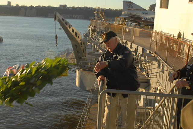 Ray Stone, a former crewmember of the USS Intrepid, and Brig. Gen. William D. R. Waff, commanding general of the 99th Regional Support Command, lay a memorial wreath in the Hudson River at the Intrepid Sea, Air and Space Museum during its annual Veterans Day ceremony, Nov. 11.