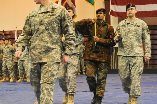 Lt. Col. Christopher Cassibry, commander of 1st Squadron (Airborne), 40th Cavalry Regiment, 4th Brigade Combat Team (Airborne), 25th Infantry Division, leads the color guard during the Nov. 14 closing ceremony of combined training Exercise Yudh Abhyas 2010 at Buckner Physical Fitness Center on Joint Base Elmendorf-Richardson, Alaska.