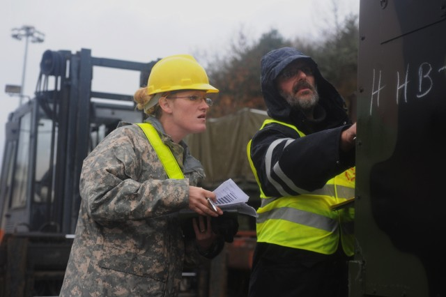 Spc. Bethany Budinski, a motor transport operator for the 66th Transportation Company, and Heinz Kahlstadt, a transportation assistant for 39th Transportation Battalion's Movement Control Team, check the serial number on a generator at the Baumholder railhead Nov. 10. Soldiers and Civilians from the 21st Theater Sustainment Command provided key movement support for the 170th Infantry Brigade Combat Team.