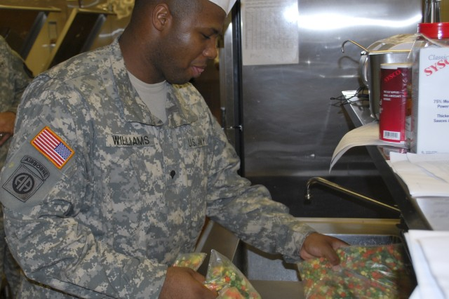 Spc. Christopher Williams, 18th Human Resources Company, prepares vegetables at the Logistics Support Area Bragg-East Consolidated Dining Facility, Fort Bragg, N.C. The DFAC is just one facet of installation logistics now under the operational control of Army Sustainment Command.