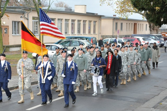 Wiesbaden military community service members, civilians and family members march on Wiesbaden Army Airfield in observance of Veterans Day.