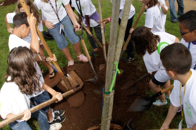 SCHOFIELD BARRACKS, Hawaii - With shovels in hand, students from Solomon Elementary School's fifth-grade class help plant trees native to Hawaii at the Kaena Community Center, here, Nov. 5, in celebration of Arbor Day.