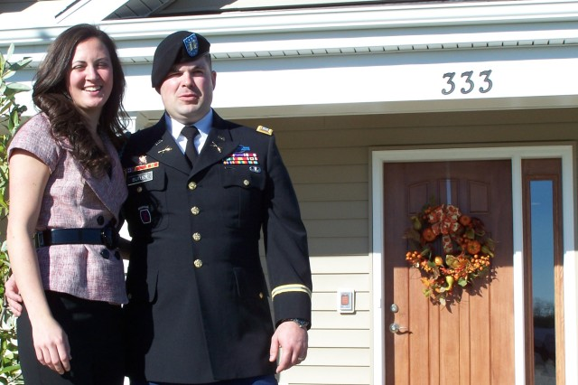 Retired Capt. Ferris Butler and his wife Laura stand outside their specially-designed house in Chester, Md., presented to them on Veterans Day by the group Homes for Our Veterans.