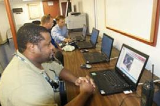 Glenn Rivers, a contract worker for the Army Field Support Battalion-Northeast Asia, trains on a computer for the yellow belt Lean Six Sigma course at the new Continuous improvement Centurion Learning Center.