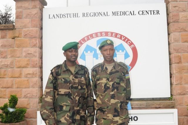 Lt. Jacques Twagirayezu (left) and Lt. Col. Marc Sebaganji, Rwanda Defense Forces, pose for a photo during a visit to American military hospital facilities at Landstuhl, Germany, November 4, 2010.