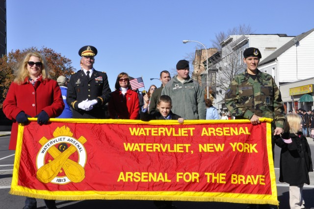 Despite the Arsenal being new to the City of Albany's Veterans Day Parade efforts, the Arsenal led the parade this year in Division One.  There were 12 marching divisions.  Arsenal Commander Col. Mark F. Migaleddi stands ready with the Arsenal's workforce and their family members prior to the start of the march.