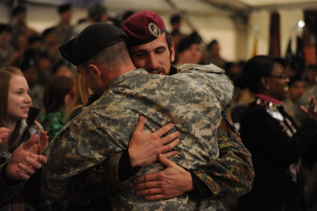 A Soldier from the U.S. Army 12th Combat Aviation Brigade, headquartered in Ansbach, Germany, embraces a German soldier rescued from the Taliban, during an April 2, 2009  ambush in Afghanistan, during the opening ceremony of ESPN's live-broadcast of the Veterans Day Sportscenter in Grafenwoehr, Germany, Nov. 11, 2010. It was the first time the German and American Soldiers had seen each other since the rescue mission.