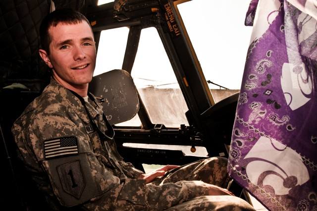 Capt. Donald Indermuehle, a Chinook helicopter pilot and K-State graduate serving in Iraq with the Enhanced Combat Aviation Brigade, 1st Infantry Division, puts his Wildcat pride on display in the cockpit of his aircraft. Indermuehle is a native of Manhattan, Kan., where he graduated from K-State in 2007. (U.S. Army photo by Spc. Roland Hale, eCAB, 1st Inf. Div. PAO)