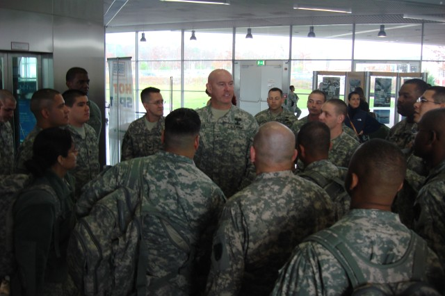 Brig. Gen. Jimmie Jaye Wells, the deputy commanding general for 21st Theater Sustainment Command, talks to Soldiers of the 266th Financial Management Center Nov. 11 at Ramstein Air Base, Germany. The Soldiers were getting ready to board a flight to Kuwait where they will be supporting Operation New Dawn and Operation Enduring Freedom.