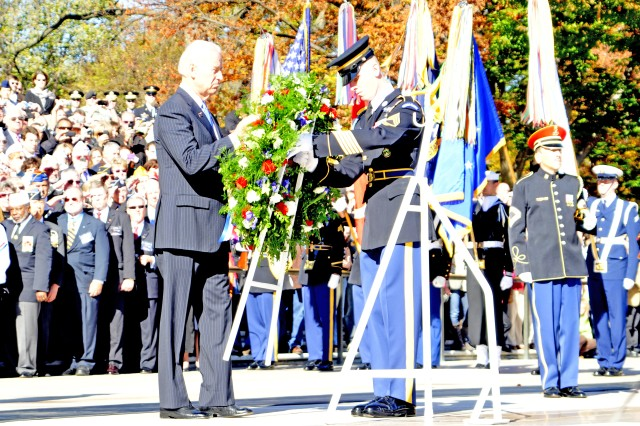Vice President Joe Biden lays a wreath, assisted by Sgt. First Class Devin McCann, Sergeant of the Guard, in a wreath laying ceremony honoring Veterans' Day at the Tomb of the Unknown Soldier, Arlington National Cemetery, Va.