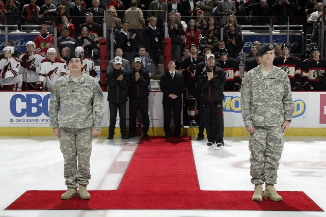 Sgt. 1st Class David Cardenas and Sgt. 1st Class Landon Lox were honored at the Chicago Blackhawks Veterans Day game on Nov., 10, 2010. Cardenas received a Bronze Star with Valor and Lox an ARCOM with Valor for their part in a 5-day operation in Afghanistan with the 20th Special Forces Group, ILARNG. Cardenas and Lox were part of a 7-man team recognized in front of over 21,000 roaring Blackhawks fans that could not get enough of these two local heroes. Photo courtesy of the Chicago Blackhawks (Bill Smith).