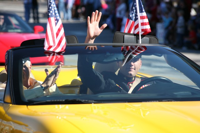 A Wounded Warrior waves during the Veterans Day parade Nov. 11. He was driving a Corvette as part of the Vettes for Vets group.