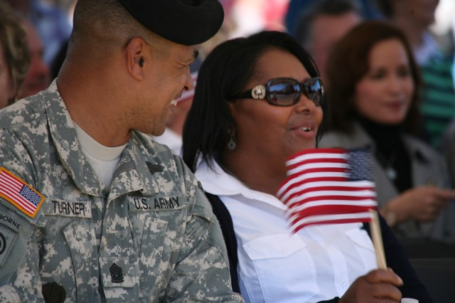 Command Sgt. Maj. Larry Turner, U.S. Army Space and Missile Defense Command/Army Forces Strategic Command command sergeant major, and his wife, Barbara, enjoy the Veterans Day parade Nov. 11.