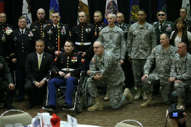 Military leaders from Redstone Arsenal pose for a photo with the Wounded Warriors honored during the Veterans Day breakfast Nov. 11.