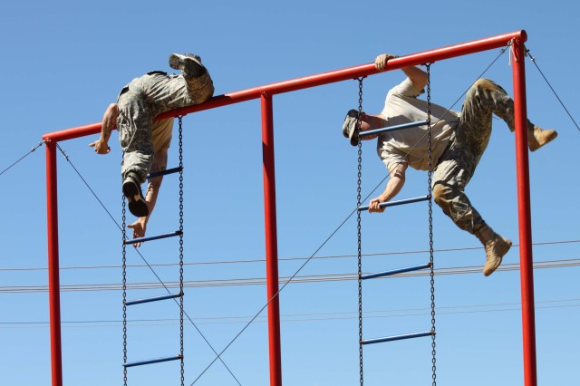 POTCHEFSTROOM, South Africa -- New York Army National Guard Pvt. 1st Class Michael Ellsworth (left) and Staff Sgt. Jeffrey Dorvee, negotiate the ladder obstacle while competing in the South African National Military Stakes Competition held Nov. 8-13. Five member of Company C 2nd Battalion 108th Infantry, based in Gloversville, NY, represented the United States Army at the annual event.