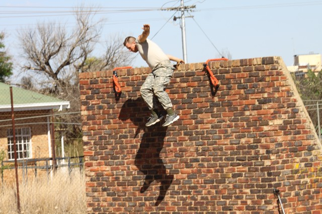 POTCHEFSTROOM, South Africa -- New York Army National Guard Pvt. 1st Class Michael Ellsworth, from Hudson Falls, NY, negotiates the inclined plane obstacle while competing in the South African National Military Stakes Competition held Nov. 8-13. Ellsworth and four other members of Company C, 2nd Battalion, 108th Infantry, based in Gloversville, NY represented the United States Army at the annual event.