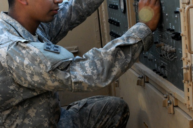 Spc. David Garcia, of Redwood City, Calif., Headquarters and Headquarters Battery, 3rd Battalion, 29th Field Artillery Regiment, 3rd Advise and Assist Brigade, 4th Infantry Division conducts a maintenance check on the firefinder radar system for Camp Adder.