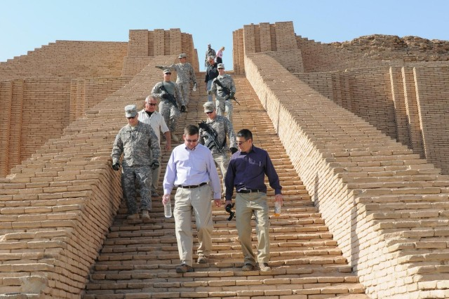 Kirk Schulz, Kansas State University president, and Jeff Morris, vice president for Communications and Marketing, lead their group down the steps of the Ziggurat of Ur Nov. 11. KSU leadership visited United States Division-South leadership deployed out of Fort Riley, Kan., to better understand what Soldiers go through to facilitate their higher education needs if Soldiers decide to continue school after deployment.
