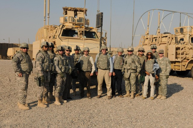 Kansas State University staff take a photo with Brig. Gen. Ricky Gibbs, United States Division-South commanding general for maneuver, and 3rd Brigade, 4th Infantry Division Soldiers at a U.S. border outpost in Iraq, Nov. 10, shortly after visiting an Iraqi general at Shalamcha Point of Entry. The four 'Wildcats' met with USD-S leadership, Basra University staff and an Iraqi general as part of their visit to Iraq.