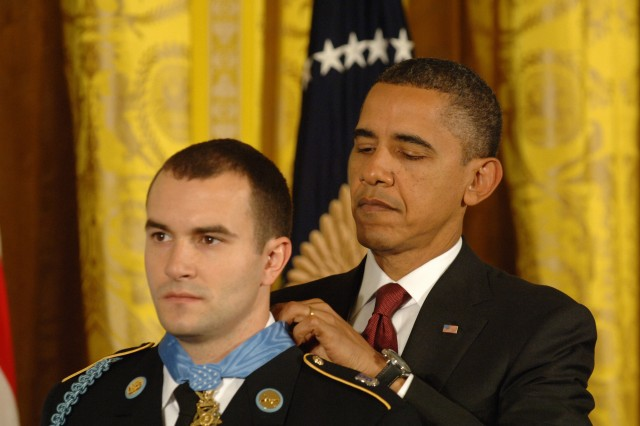 President Barack Obama presents the Medal of Honor to Staff Sgt. Salvatore Giunta in the East Room of the White House, November 16, 2010, for his actions of valor during an enemy attack in the Korengal Valley of Afghanistan, Oct. 2007.