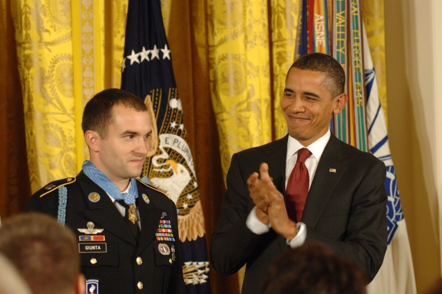 President Barack Obama applauds Staff Sgt. Salvatore Giunta in the East Room of the White House, November 16, 2010, after presenting the Medal of Honor to him for his actions of valor during an enemy attack in the Korengal Valley of Afghanistan, Oct. 2007.