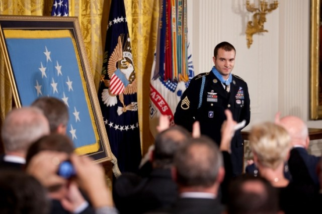 Staff Sgt. Salvatore Giunta is recognized by the audience after receiving the Medal of Honor from President Barack Obama during a ceremony in the East Room of the White House, November 16, 2010. (Official White House Photo)