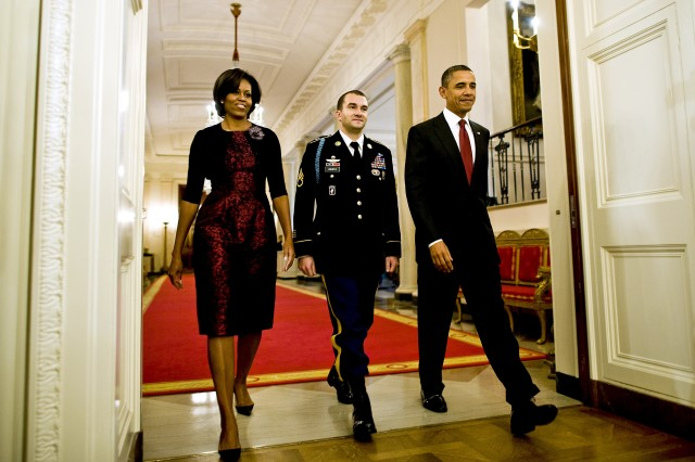 President Barack Obama, Army Staff Sgt. Salvatore Giunta and First Lady Michelle Obama enter the East Room of the White House in Washington, D.C., to begin Giunta's Medal of Honor ceremony, Nov. 16, 2010. Giunta is the first living veteran from the wars in Iraq and Afghanistan to receive the award.