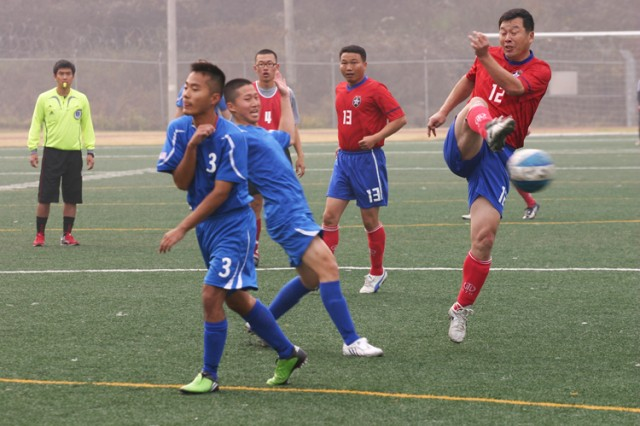 2nd Infantry Division Republic of Korea Army Support Group forward and coach Lee Kyun-cheol takes a shot on goal. He scored three of his team's four goals in the championship final.