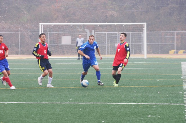FCC CRC Indians midfielder Jared Hafen splits the defense of Lee Hyun-woo (left) and Jung Hae-sick of the 2nd Infantry Division's Republic of Korea Army Support Group in the championship game of the Warrior Country Post-Level Invitational Soccer Tourmament at Casey Garrison's Schoonover Bowl Nov. 6. The ROKA Support Group won the game, 4-2.