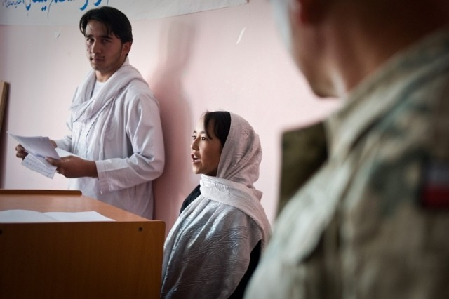 Participants of a recently-completed English course display their abilities during a presentation n Ghazni City.  The seven-month course, provided by the Ghazni Provincial Reconstruction Team and Afghan non-governmental organization, Roshnaee Social Service Organization, was a continuation of 2009 classes and focused on English and computer skills.