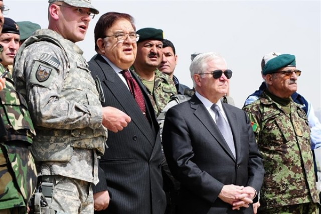 Col. Michael Herman of the South Dakota Army National Guard briefs Afghan Defense Minister Abdul Rahim Wardak, center-left, and U.S. Defense Secretary Robert M. Gates, center-right, on the progress of training Afghan National Army units in September 2010 at Kabul Military Training Center near Kabul, Afghanistan.