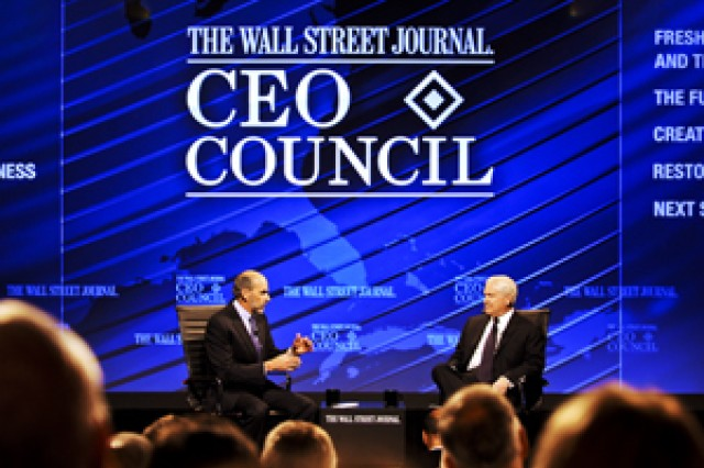 Defense Secretary Robert M. Gates, right, answers questions from Gerald F. Seib, the Wall Street Journal's executive Washington editor, before a large audience at the newspaper's CEO Council in Washington, D.C., Nov. 16, 2010. The interview focused on upcoming budget cuts within the department. Seib also is the Wall Street Journal's assistant managing editor.